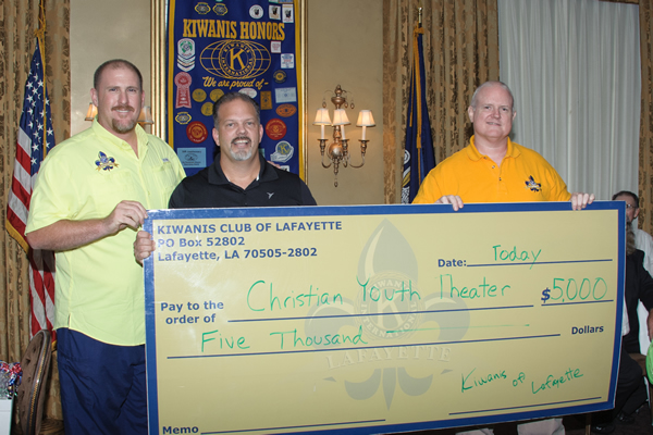 Kiwanians Dr.Bob Lejeune (l) and club president Michael Smith (r) present CYT Executive Director Gerald Broussard with a check for $5,000.